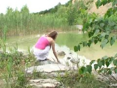 A gorgeous blue eyed amateur girl drops down to suck her boyfriend off by the lake