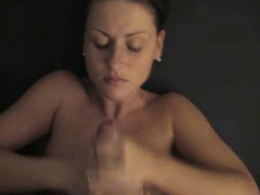 Pretty chick gets out of her clothes and handles a cock with her hands and her tits
