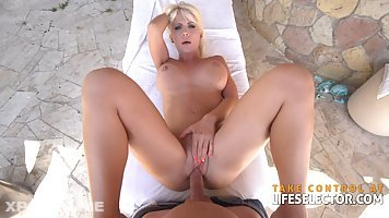 Sexy blonde milf Tiffany Rousso rides a hard cock and gets her boy some footjob outdoors