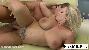 Blonde milf, Rachel Love is playing with her huge tits and her lover's hard dick