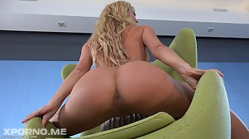 Big ass blonde milf in shoes with high heels, Cherrie DeVille is posing in super thin pantyhose